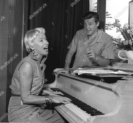 Roger Moore actor with wife / girlfriend Dorothy Squires actress at home.