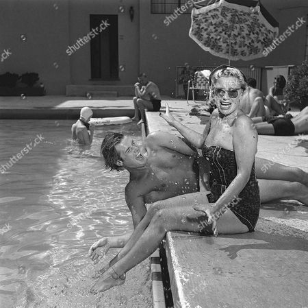 Roger Moore actor with wife / girlfriend Dorothy Squires actress at home in 1977