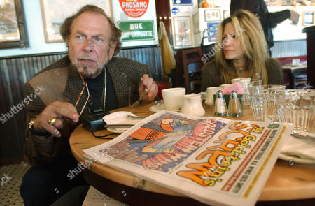 """GOLDSTEIN Al Goldstein, left, publisher of """"Screw"""" magazine, sits for an interview at a coffee shop in New York with his longtime assistant Terre Galizio, in New York. After 35 years in the business of titillating and offending, Goldstein says his magazine can't compete anymore. The audience is just as large, he says, but the Internet has transformed the product and its delivery"""