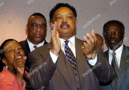 THOMAS Rev. Jesse Jackson, center, speaks with reporters at the Alabama Statehouse in Montgomery, following a meeting with members of the House black caucus. Jackson called for an investigation into the hiring of Mike Shula as the head football coach of Alabama. From left are: State Rep. Laura Hall, D-Huntsville; Rev. Tommy Lewis, Jackson; and Rep. James Thomas, D-Selma