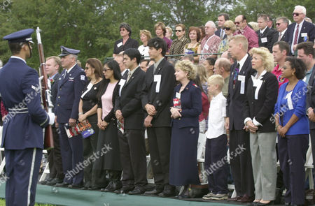 RELATIVES AND FRIENDS In the front row from left, astronaut Andrew Thomas, Israeli Brig. Gen. Rani Falk, Rona Ramon, the wife of Israeli astronaut Ilan Ramon, Lani McCool, Sean McCool, and Cameron McCool, the wife and sons of pilot Williams McCool, June Scobee Rodgers, the wife of Dick Scobee the commander of Challenger, Iain Clark, and Jon Clark, the son and husband of Laurel Clark, Evelyn Husband, the wife of commander Rick Husband, and Sandra Anderson, the wife of mission specialist Michael Anderson stand during ceremonies honoring the space shuttle Columbia crew at the Kennedy Space Center visitors center in Cape Canaveral, Fla