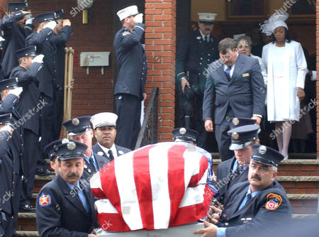 JUANITA DOROTHY RICHARD The casket of Captain Vernon Richard is carried by New York City Firefighters from his funeral service at the First Baptish Church in Spring Valley, New York, . His wife Dorothy, right, and mother Juanita follow behind. Richard was one of nine firefighters killed on Sept. 11th from Ladder Company 7 in Manhattan