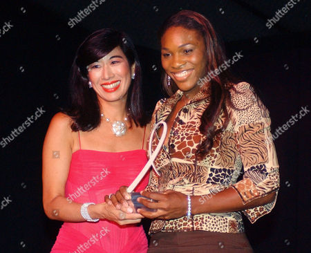 """Avon Chairman and Chief Executive Officer Andrea Jung, left, presents tennis star Serena Williams with the """"Celebrity Role Model Award,"""" during the annual """"Kiss Goodbye to Breast Cancer"""" ceremony, in New York"""