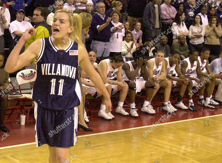 Stock Picture of MOORE Villanova's Trish Juhline (11) celebrates their 52-48 upset win over Connecticut at the Big East Women's Basketball Championship game, in Piscataway, N.J. From left, Connecticut's Diana Taurasi, Morgan Valley, Barbara Turner, Ann Strother,Willnett Crockett, Ashley Battle and Jessica Moore sit on the bench
