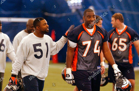 MOBLEY SALAAM Denver Broncos linebacker John Mobley (51) shares a laugh with tackle Ephraim Salaam after practice at mini-camp at the Broncos training facility in Denver on