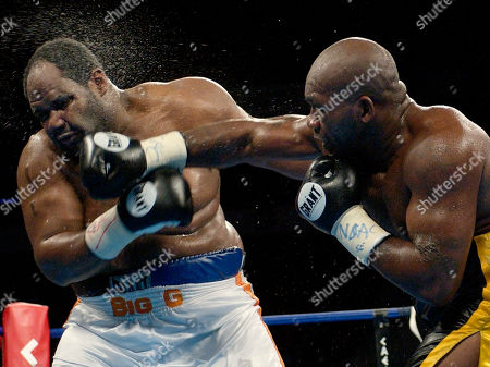 BROWN WILLIAMS Sherman Williams, of the Bahamas, right, throws a right to the head of Gabriel Brown during the tenth round of their heavyweight bout, in Las Vegas