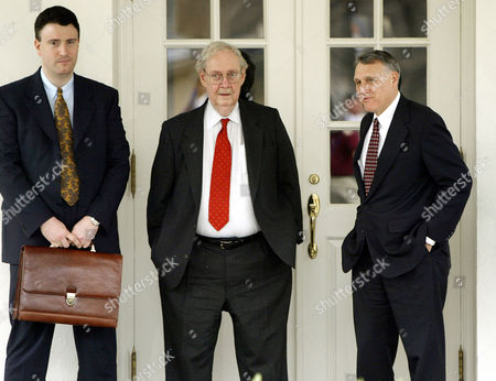 Stock Photo of BORK KYL Former federal appeals court Judge Robert Bork, center, and Sen. Jon Kyl,R-Ariz., right, wait to be picked up after meetings, at the White House. Man at left is unidentified