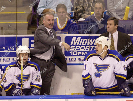 STILLMAN QUENNEVILLE BURE St. Louis Blues head coach Joel Quenneville, center, waves his arms at the officials after a penalty was called on the Blues during the first period of their NHL playoff game against the Vancouver Canucks in the first period of game three of their best-of-seven playoff series against the Canucks in St. Louis, . On the bench are Valeri Bure (13) and Cory Stillman (61