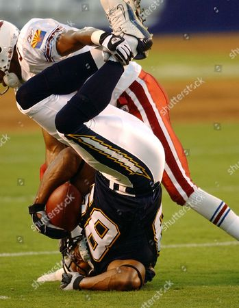 Stock Picture of BOSTON STARKS San Diego Chargers receiver David Boston lands on his head while being taken down by Arizona Cardinals' Duane Starks after a 14-yard pass completion for a first down during the first quarter of a preseason game, in San Diego