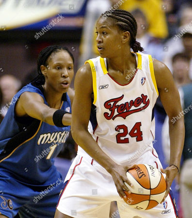 CATCHINGS Indiana Fever forward Tamika Catchings (24) looks to pass against Washington Mystics forward Chamique Holdsclaw during the first half, in Indianapolis. She is The Face of the Indiana Fever, with her mug on everything from billboards, ticket brochures and newspaper ads. She's already accomplished something much harder than winning a championship in the often ignored WNBA, creating a buzz