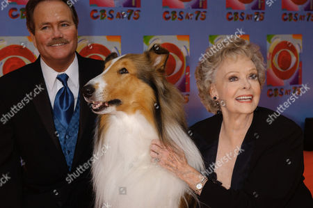 """June Lockhart, right, who played the character of Ruth Martin, mother of Timmy Martin, played by Jon Provost, left, during the classic series """"Lassie,"""" poses for a photograph with Lassie, 9th generation, during arrivals at CBS's 75th anniversary celebration, in New York"""