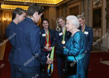 Queen Elizabeth II and the women's hockey team, Laura Unsworth, Hollie Webb and Alexandra Danson