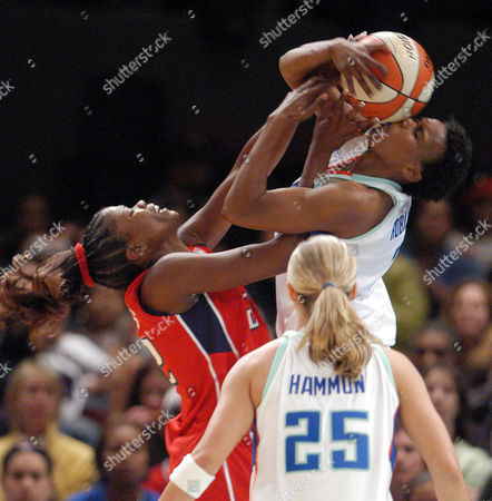 Houston Comets' Sheryl Swoopes battles for the ball with New York Liberty Crystal Robinson as Becky Hammon looks on during the second half, at Madison Square Garden in New York