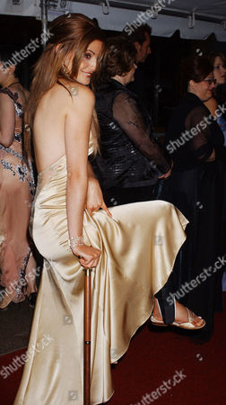 """Actress Alexis Thorpe of """"Days of Our Lives,"""" uses a cane to assist with an injured leg as she arrives at the 30th Annual Daytime Emmy Awards in New York"""
