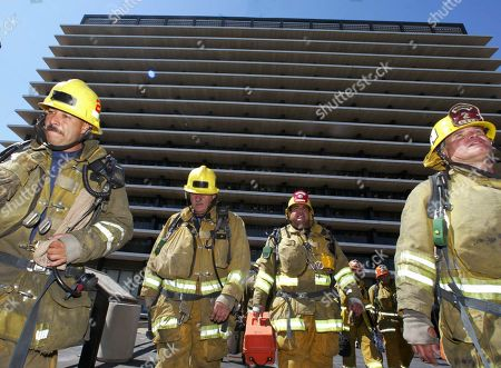Los Angeles firefighters leave the city's Department of Water and Power headquarters, in downtown Los Angeles, after a fire broke out in rubbish atop the structure,said Fire Department Battalion Chief Joe Klein. The building was evacuated during the blaze, which burned for about 10 minutes