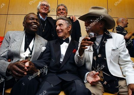 GADD Drumming icons, seated from left, Elvin Jones, Louis Bellson and Roy Haynes, and standing, Freddy Gruber, left, and Steve Gadd, gather at a reception prior to the 2003 Zildjian American Drummers Achievement Awards at the Berklee College of Music in Boston, . Gadd is the recipient of the 2003 award, which is given by cymbal maker Zildjian to honor musicians who have made extraordinary contributions to the art of drumming. Jones, Bellson and Haynes, who trace their roots to the birth of bebop and jazz, received the award in 1998