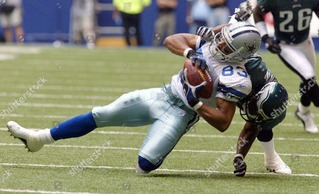 GLENN BROWN Dallas Cowboys wide receiver Terry Glenn (83) is tackled by Philadelphia Eagles cornerback Sheldon Brown (24) after picking up four yards and first down in the first quarter, in Irving, Texas