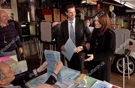 NEWSOM San Francisco mayoral candidate Gavin Newsom, center, asks his wife Kimberly Guilfoyle Newsom, right, if she is sure who to vote for as they prepare to cast their ballots, in San Francisco