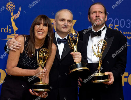"Stock Photo of BURGESS From left, writers Robin Green, David Chase and Mitchell Burgess appear backstage with their awards for outstanding writing for a drama series for their work on ""The Sopranos"" at the 55th annual Primetime Emmy Awards, in Los Angeles"