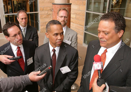 GREEN District of Columbia City Councilman Harold Brazil, right, talks to reporters after making a presentation to Major League Baseball to pitch Washington as the future home for the Montreal Expos, at Bank One Ballpark in Phoenix. Looking on from left are Bobby Goldwater, Andrew Altman, Eric Price and Stephen Green, also members of the delegation