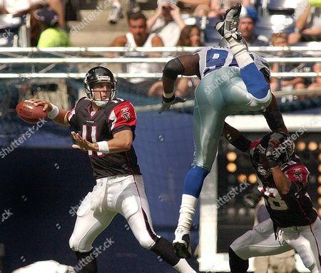 JOHNSON DUNN EKUBAN Atlants Falcons quarterback Doug Johnson (11) looks to throw as teammate Warrick Dunn (28) blocks Dallas Cowboys' Ebenezer Ekuban (96) in the first quarter in Irving, Texas