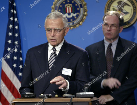 GLENN FITZGERALD Gene Glenn, of the National Insurance Crime Bureau, left, and U.S. Attorney Patrick J. Fitzgerald, right, answer questions from the media about Operation Soft Tissue during a news conference, in Chicago. The sting operation, in which an agent posed as a corrupt lawyer bilking insurance companies for over $1 million in claims, resulted in indictments charging 45 defendants with participating in the alleged fraud schemes