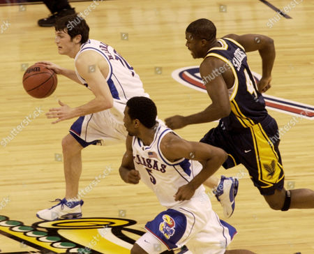 LANGORD HINRICH SANDERS Kansas' Kirk Hinrich, left, and Keith Langford (5) run the floor ahead of Marquette's Terry Sanders, right, in Men's NCAA Final Four semifinal game, in New Orleans. Kansas defeated Marquette 94-61, and will face Syracuse in Monday's final