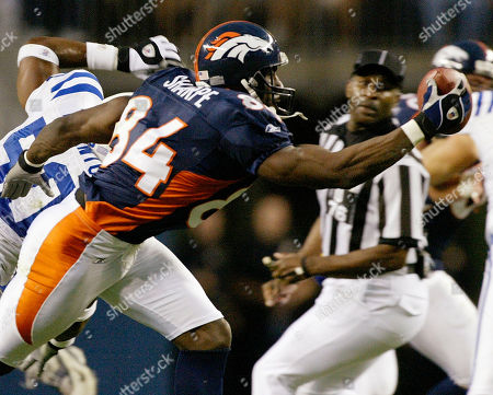 SHARPE THORNTON Denver Bronocs tight end Shannon Sharpe (84) making a one-handed catch for first down yardage against Indianapolis Colts defender David Thornton (50) during second quarter action, in Denver. Sharpe will be inducted into the Pro Football Hall of Fame next weekend