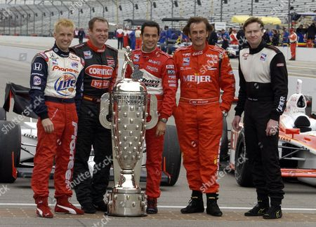 LAZIER The five former winners entered in the field for the 2003 Indianapolis 500 pose on the start/finish line at the Indianapolis Motor Speedway on the opening day of practice in Indianapolis . The are, left to right, Kenny Brack, Al Unser Jr. Helio Castroneves, Arie Luyendyk and Buddy Lazier