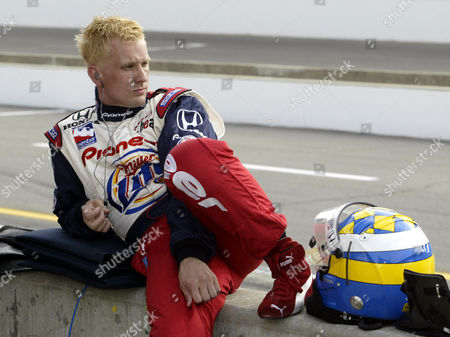 BRACK Sweden's Kenny Brack relaxes on the wall in the pit area during a break in practice at Indianapolis Motor Speedway, . Brack's top practice speed was 230.288 mph