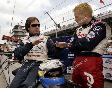 BRACK VASSER Race car drivers Jimmy Vasser, left, and Sweden's Kenny Brack discuss the handling of Vasser's car following a practice session at the Indianapolis Motor Speedway . Vasser will attempt to qualify on Sunday for the race