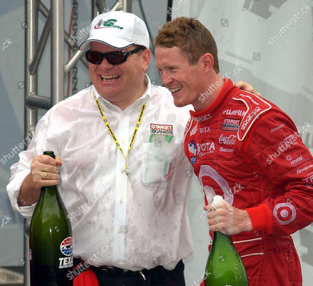 DIXON GANASSI 2003 IRL champion Scott Dixon, right, and team owner Chip Ganassi celebrate following the IRL Chevy 500 race, at Texas Motor Speedway in Fort Worth, Texas. Kenny Brack was seriously injured when his car was hit from behind and pinwheeled down the track before breaking apart, marring Gil de Ferran's victory and Dixon's championship