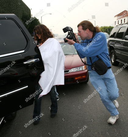 Brooke Burke leaving Fred Segal with her baby daughter Heaven Rain Charvet covered under a blanket