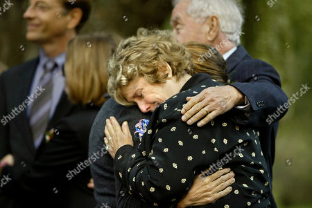 KELLY At a ceremony honoring four U.S. journalists who died covering the war on terrorism, Marguerite Kelly, mother of journalist Michael Kelly who was killed in Iraq, is embraced by his widow, Madelyn, and father Tom, at right, at the War Correspondents Memorial, near Burkittsville, Md., . The journalists were honored by the Bush administration on Wednesday as brave protectors of the First Amendment. David Bloom of NBC News; Michael Kelly of The Atlantic Monthly and The Washington Post; Elizabeth Neuffer of The Boston Globe; and Daniel Pearl of The Wall Street Journal were memorialized in the ceremony