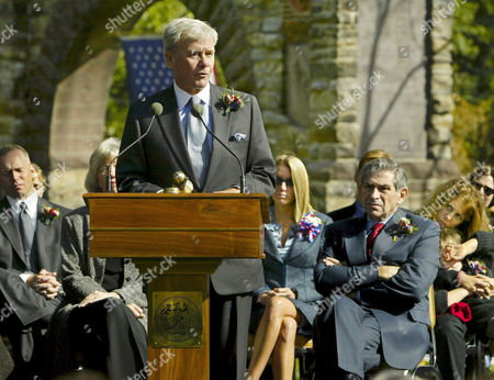 BLOOM NBC News anchor Tom Brokaw praises the lives and work of four U.S. journalists who died covering the war on terrorism, during a ceremony at the War Correspondents Memorial Arch, near Burkittsville, Md., about 50 miles northwest of Washington, . Those honored were: David Bloom of NBC News; Michael Kelly of The Atlantic Monthly and The Washington Post; Elizabeth Neuffer of The Boston Globe; and Daniel Pearl of The Wall Street Journal. Seated behind Brokaw at right are Melanie Bloom, widow of NBC reporter David Bloom, Deputy Secretary of Defense Paul Wolfowitz, and Madelyn Kelly, widow of journalist Michael Kelly, holding their son Tom, 7