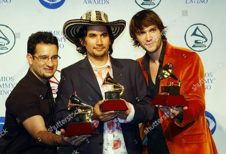LOPES VILLAMIZAR FREIRE Jorge Villamizar, center, Javier Freire, right and Andre Lopes of the group Bacilos show off their awards at Latin Grammy Awards at the American Airlines Arena in Miami . Bacilos won for Best Pop Album by a Duo or Group with Vocal and for Best Tropical Song