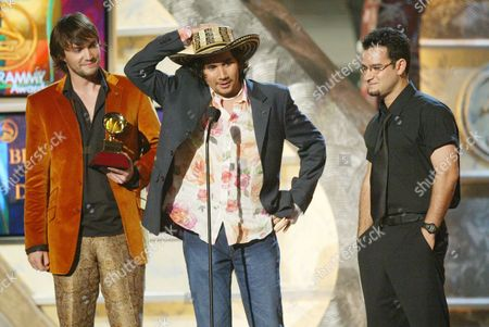 LOPES FREIRE VILLAMIZAR Jorge Villamizar,center, singer for the Miami based group Bacilos, accepts the Latin Grammy Award for Best Pop Album by a Group at the 4th Annual Latin Grammy Award in Miami . To the left are band members Andres Lopes and Javier Freire. Bacilos also won a Latin Grammy for Best Tropical Song