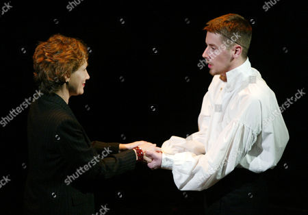 """Original cast member Randy Graff, left, sings with Chris Alan Derflinger, of Metuchen High School in New Jersey, during the final performance of the Broadway musical """"Les Miserables"""" at New York's Imperial Theatre . Sunday was the final day on Broadway for the hit, after more than 16 years and 6,680 performances, second only to """"Cats,"""" Broadway's longest-running show. Though the musical will no longer perform on Broadway, high schools continue to perform the hit"""