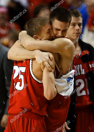 GRINNON Maryland guard Steve Blake (25) is hugged by forward Nik Caner-Medley after Maryland defeated UNC Wilmington 75-73 on a last-second shot in the NCAA South Regional basketball tournament in Nashville, Tenn. on . At right is forward Mike Grinnon