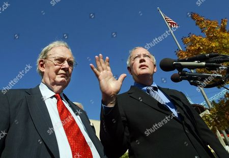 Stock Picture of BORK STARR Kenneth Starr, a lobbyist for Microsoft, right, accompanied former Supreme Court nominee Robert Bork, representing Microsoft's competitors, gestures while meeting reporters outside court in Washington, after a Microsoft hearing. The antitrust case against Microsoft returned to the U.S. appeals court where the world's largest software company already has won significant victories since the government began investigating its business practices nearly a decade ago