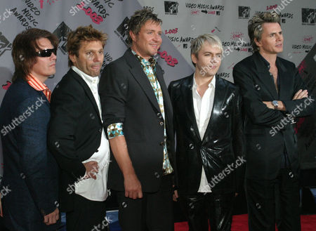 Members of the Band Duran Duran, from left, Andy Taylor, Roger Taylor, Simon LeBon, Nick Rhodes, and John Taylor, arrive for the MTV Video Music Awards at New York's Radio City Music Hall