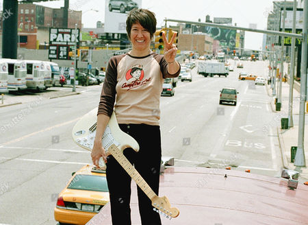 SHOCKED Musician Michelle Shocked gestures on top of her tour bus in New York, . Shocked was an overnight sensation 15 years ago with her major-label debut, ''Short Sharp Shocked.'' But just four later her star began to fade, hastened by a bitter legal dispute with her record label. In recent months Shocked has begun to emerge from a professional and personal wilderness. Her new record label, Mighty Sound, is reissuing her first four albums, including ''Short Sharp Shocked,'' which is coming out Tuesday