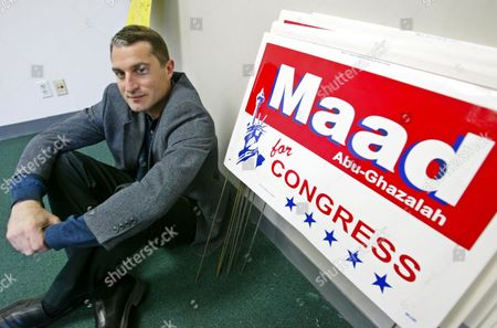 """ABU GHAZALAH Maad Abu-Ghazalah, a Palestinian Muslim running for the 12th congressional district seat held by U.S. Rep. Tom Lantos, sits on the floor of his campaign headquarters next to campaign signs in Burlingame, Calif., . In his run for Congress, friends have advised Abu-Ghazalah to change his name. Get rid of """"Abu"""" because it will remind people of Osama bin Laden, they've told him. But Abu-Ghazalah has refused, and his full name remains on his red, white and blue campaign signs, alongsideapicture of the Statue of Liberty"""