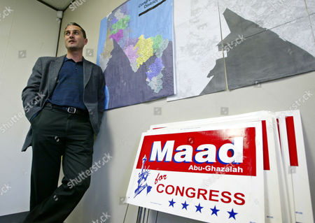 """ABU GHAZALAH Maad Abu-Ghazalah, a Palestinian Muslim running for the 12th congressional district seat held by U.S. Rep. Tom Lantos, stands by maps of his district at his campaign headquarters in Burlingame, Calif., . In his run for Congress, friends have advised Abu-Ghazalah to change his name. Get rid of """"Abu"""" because it will remind people of Osama bin Laden, they've told him. But Abu-Ghazalah has refused, and his full name remains on his red, white and blue campaign signs, alongside a picture of the Statue of Liberty"""