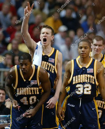 SANDERS NOVAK CHAPMAN Marquette players, from foreground left, Terry Sanders, Steve Novak and Joe Chapman watch and encourage their teammates in the second half against Pittsburgh during an NCAA Midwest Regional semifinal, in Minneapolis