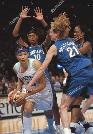 HOLDSCLAW New York Liberty Tamika Whitmore (44) protects the ball from Washington Mystics defender Stacey Dales-Schuman (21) in the first half at Madison Square Garden in New York. Washington Mystics Murriel Page (10) and Chamique Holdsclaw (1), far right, look on in the background