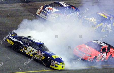PARK Kurt Busch (97) gets sideways in front of Jeff Burton (99), Steve Park (30), and Robby Gordon (31) during the NASCAR Pepsi 400, at the Daytona international Speedway in Daytona Beach, Fla