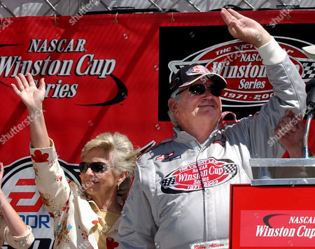 ALLISON Former NASCAR great Bobby Allison and his wife, Judy, wave to fans at the Talladega Superspeedway during pre-race ceremonies to honor the 10-year anniversary of the death of their son, driver Davey Allison, who died as a result of injuries suffered in a helicopter crash at the speedway. Allison also drove his old car around the Talladega Superspeedway, prior to the start of the NASCAR EA Sports 500 race