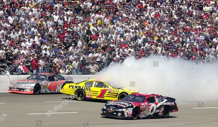 MARLIN SPRAGUE PARK Steve Park (1) spins out coming out of turn four as Sterling Marlin (40) hits the wall and Jack Sprague (0) drives by during the Samsung/Radio Shack 500 race, at Texas Motor Speedway in Fort Worth, Texas