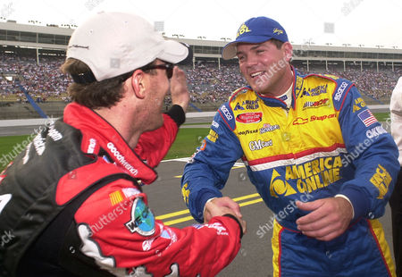 PARK HARVICK Steve Park, right, is congratulated by teammate Kevin Harvick, left, after winning the pole position for The Winston Open in Concord, N.C., with a speed of 184.244 mph